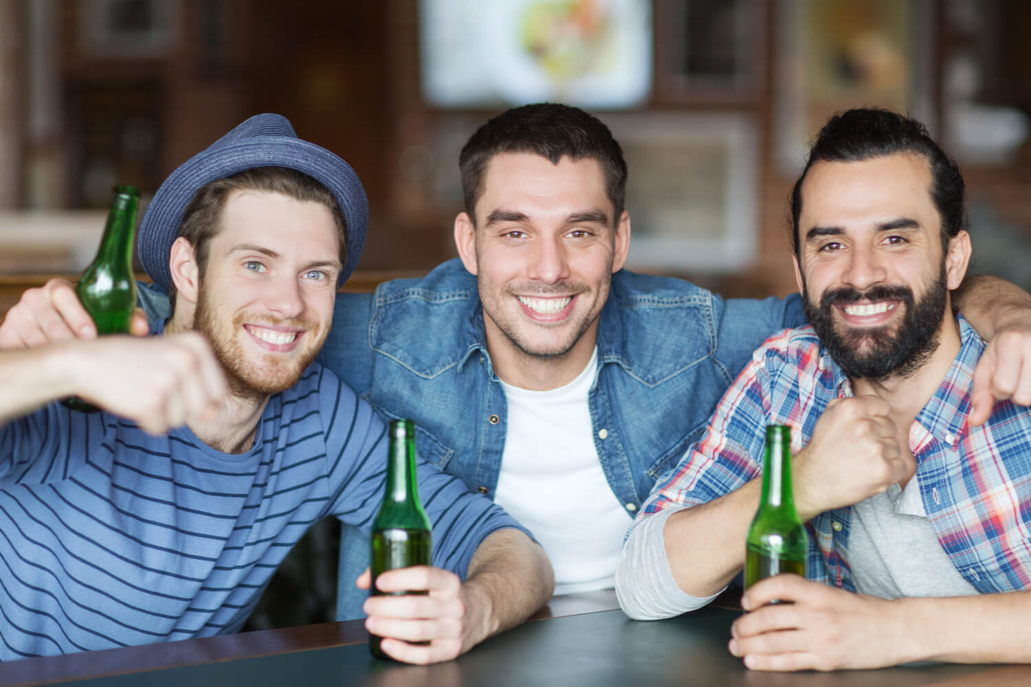 A trio of young men smiles into the camera before commencing their Wisconsin Dells bachelor party.